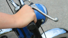 Turning throttle handle on a moped - stock footage