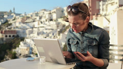 Woman doing online shopping on laptop in cafe HD Stock Footage