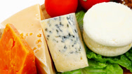 Stock Video Footage of soft feta cheese with aged delicatessen cheeses