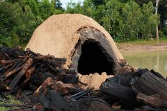 Natural incinerator that it made from clay to burn firewood Stock Photos