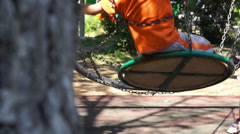 Unidentified child on a swing Stock Footage