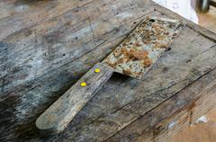 Old rusty kitchen knife on dirty table Stock Photos