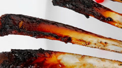 Meat ribs on white plate Stock Footage