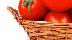 Fresh tomatoes on green branch Stock Footage