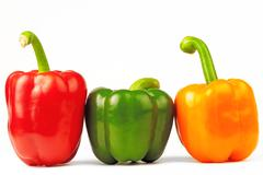 Three multi-colored paprikas on the white isolated background Stock Photos