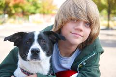 boy with dog - stock photo