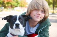 Stock Photo of boy with dog