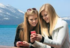 girls on cell phone - stock photo