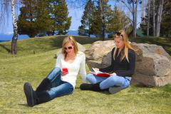 teens relaxing in park - stock photo