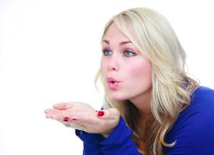 woman blowing air over hands. - stock photo