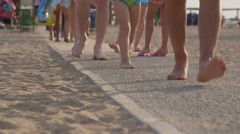 Vacationers going to the summer beach - stock footage