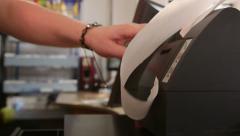 Cashier loading paper tape in cash register Stock Footage