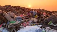 Rubbish Dump At Sunset Stock Footage
