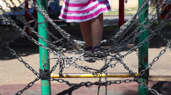 Girl at the playground Stock Footage