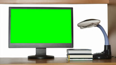 Monitor with a green screen on the computer desk Stock Footage
