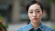 Stock Video Footage of Asian woman sad serious face