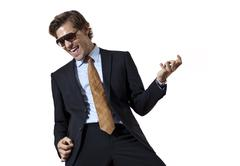 cool businessman playing air guitar - stock photo