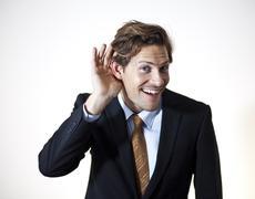 interested businessman listening - stock photo