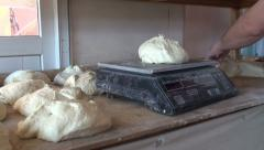 Weighing dough for bread in Georgia Stock Footage