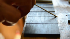 Luthier makes the frets of a guitar Stock Footage