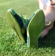 green sole of shoes l - stock photo