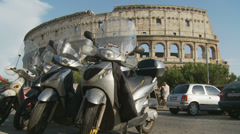 The Colloseum & scooters (slomo dolly) Stock Footage