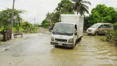 Truck Driving Through Flooded Area Stock Footage
