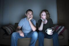 couple watching television bored - stock photo
