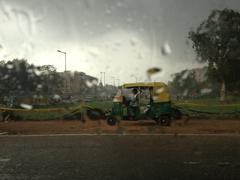Indian tuktuk waiting for rain to pass - stock photo
