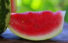 watermelon and slice on table - stock photo