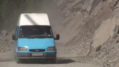 Minivan drives across road that was cleared after landslide, Georgia Stock Footage