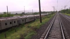 Tbilisi Baku railway, passing old train carriages Stock Footage