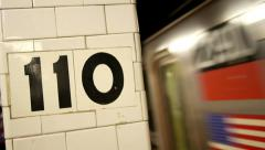 Manhattan Subway Train Approaches 110th Street Platform Stock Footage