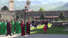 Procession around Georgian cathedral Stock Footage