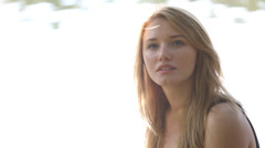 Sexy girl in sunshine by river Stock Footage