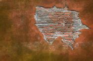 Stock Photo of cracking grunge weathered vintage and fragment of red brick wall using as bac