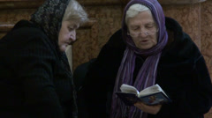 Stock Video Footage of Elderly women in Georgian church