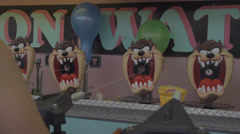 Carnival - water gun game, balloons pop 120fps slow motion Stock Footage