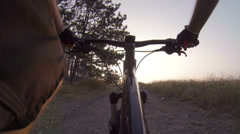 Cyclist riding mountain bike at sunrise Stock Footage