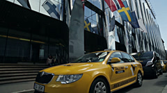 Flags and taxi at the business center in Tallinn Stock Footage