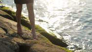 Stock Video Footage of Female feet on the seashore