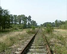 Overgrown railway embankment + pan creek Stock Footage