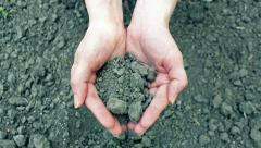 Plowed land in hands Stock Footage