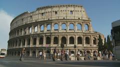 Segways cross road to Colosseum (slomo) Stock Footage
