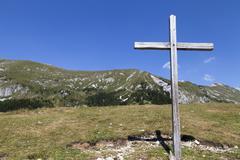 Wooden cross on the mountain Stock Photos