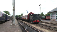 Stock Video Footage of Steam train arrives at retro railway station - on camera
