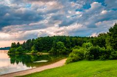 evening clouds over the shore of lake marburg, codorus state park, pennsylvan - stock photo