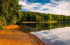 Stock Photo of evening light on the shore of lake marburg, in codorus state park, pennsylvan