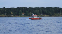 Tugboat passes ferry boat Stock Footage