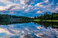 Stock Photo of reflection of beautiful evening clouds in lake marburg, codorus state park, p